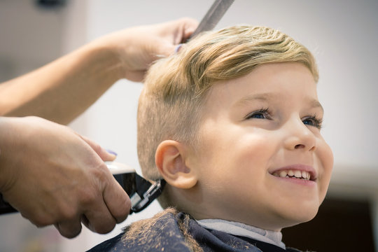 Cute kid at hairdresser's.