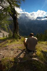 Man studying a map in the mountain landscape, Triglav National Park, Slovenia