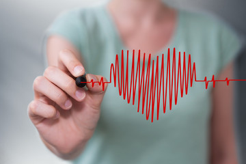 Businesswoman drawing a heart beat sketch