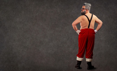 Santa Claus is a modern hairstyle with a naked body behind the back of the copyspace.