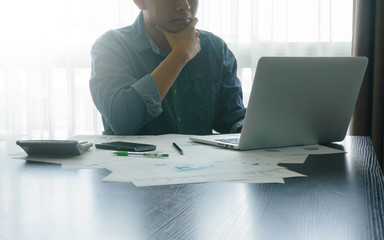 businessman thinking of business plans, working on laptop. finances and business concept