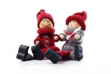 Cute christmas couple figurines on isolated white studio background.