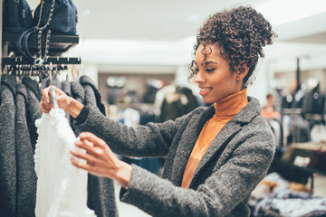 Black young woman doing shopping in a store