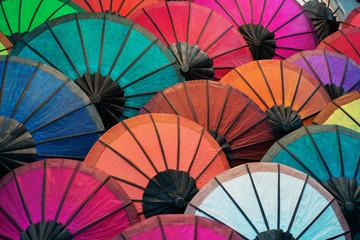 Colorful traditional paper umbrellas on market. Laos, Luang Prabang