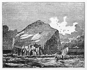 Ancient view of a rock in the middle of a rough sea, little small medieval town on it, Bass Rock Scottish isle. Old Illustration by unidentified author published on Magasin Pittoresque Paris 1834
