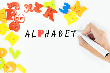 """Hand writing word """"alphabet"""" for learning: Concept about education."""