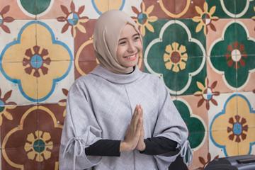 asian muslim woman welcoming