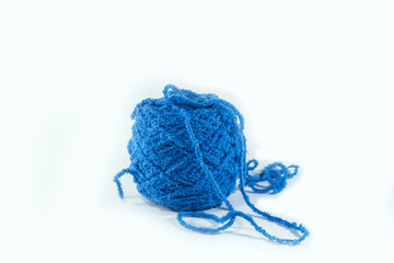 Blue ball of yarn on a white background.