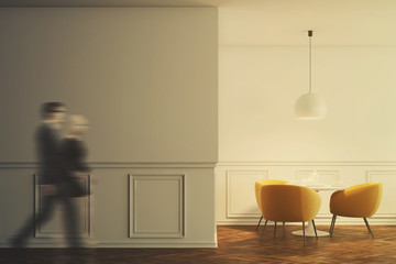 White cafe interior, orange chairs, wall toned