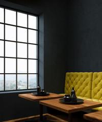 Black cafe corner, yellow sofa