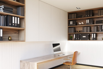 White home office corner with a wooden floor, a desk, a computer, bookshelver and an orange chair. 3d rendering mock up