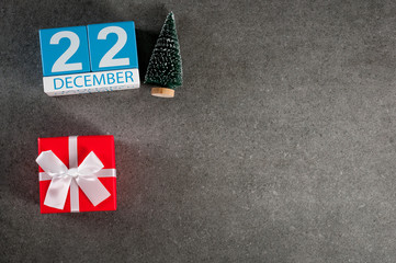 December 22th. Image 22 day of december month, calendar with x-mas gift and christmas tree. New year background with empty space for text, mockup