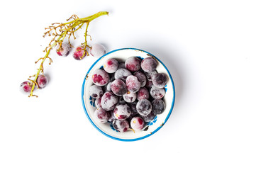 Frozen grapes cluster on white background