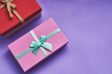 Gift boxes on purple background