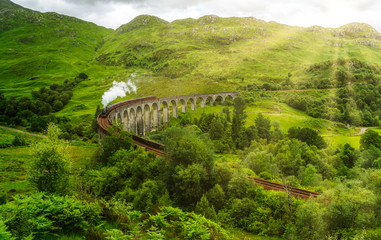 Glenfinnan Railway Viaduct with the Jacobite steam, in Lochaber area of the Highlands of Scotland.