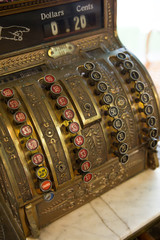 Closeup of an antique style cash register in a shop. Retro cash machine.