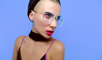 Sensual Tomboy model in fashionable glasses and choker accessories Trends make-up style