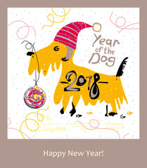 Yellow Terrier in a Santa cap and a Christmas ball. 2018. Happy New Year greeting card.