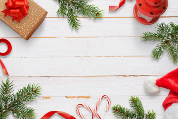Christmas decorations on white wooden table. Free space in the middle for text. Top view.