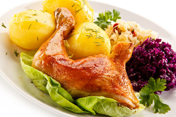 Roast chicken legs with potatoes and vegetables