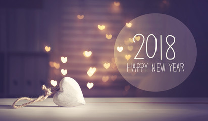 New Year 2018 message with a white heart with heart shaped lights