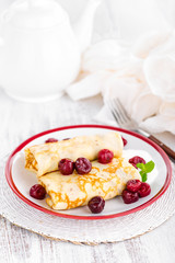 Sweet pancakes with cherry