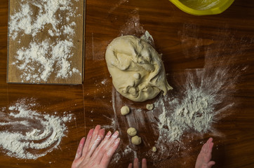 Mom and daughter are making flour out of flour to cook dumplings