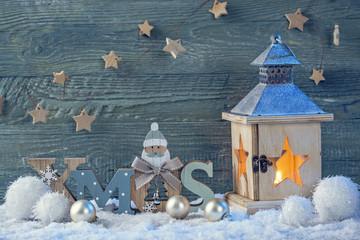 Burning latern and christmas decoration