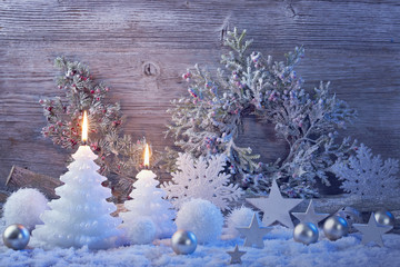 Burning candles and christmas decoration