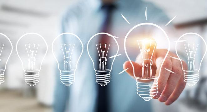 Businessman touching a sketch lightbulb