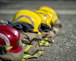 Shallow depth of field, close up of fire training helmets in a line