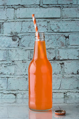 A bottle of orange soda