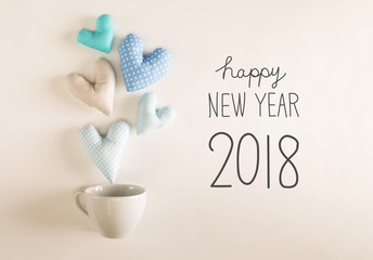 New Year 2018 message with blue heart cushions coming out of a coffee cup