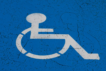 wheelchair symbol on handicap parking spot