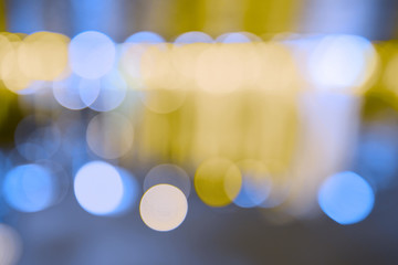 Artistic bokeh background. Defocused circular yellow and blue lights. Without black color on background. .