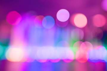 Artistic bokeh background. Defocused circular red, yellow and magenta lights. Without black color on background.