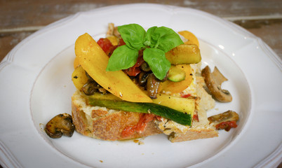 freshly prepared open faced vegetable sandwich on homemade bread
