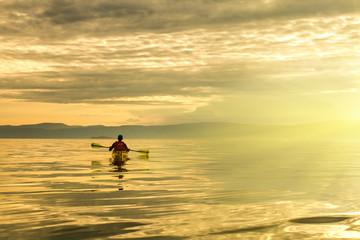 A man in a sea kayak on Lake Baikal
