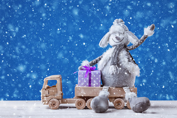 Christmas background with snowman in hat and fur coat.