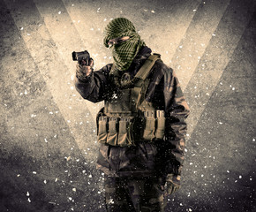 Portrait of a dangerous masked armed soldier with grungy background