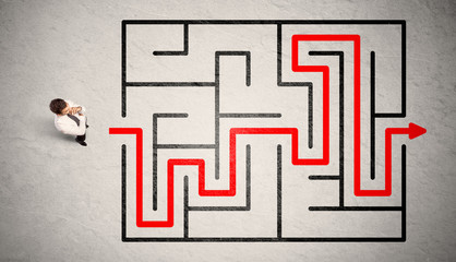 Wall Mural - Lost businessman found the way in maze with red arrow