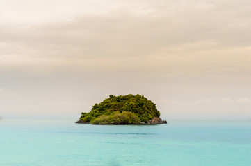 Lonely green island in the sea