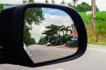 Street view into Side mirror of car