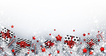 Christmas background with fir branches and gifts.