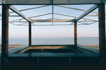 View of the sea through a wooden gazebo
