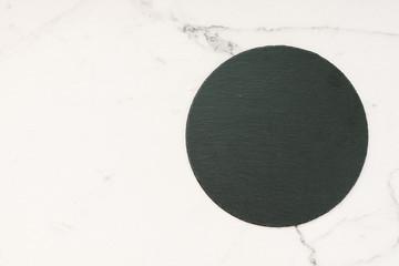 Slate on white marble stone