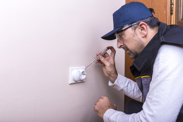 an electrician repairs home electrical installations