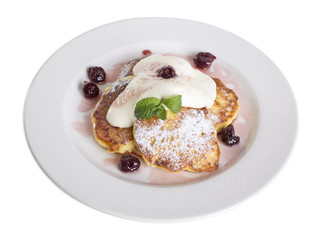 Pancakes with sour cream and cherries.