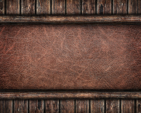 leather background framed by old wooden planks