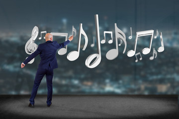 Businessman in front of a wall with 3d render music notes